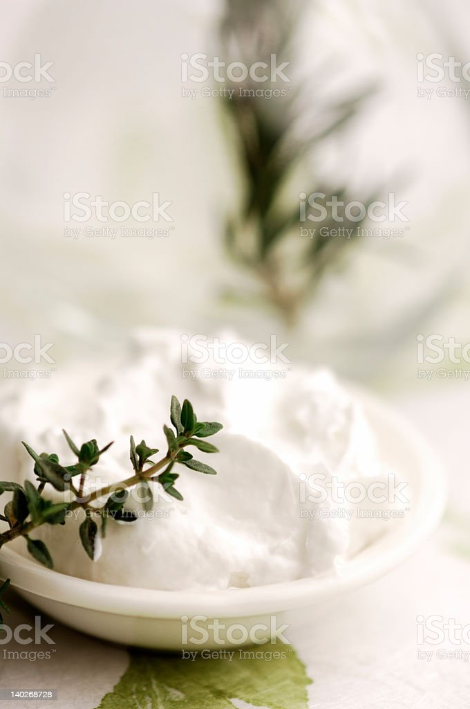 A close-up of a bowl of herbal skin treatment royalty-free stock photo