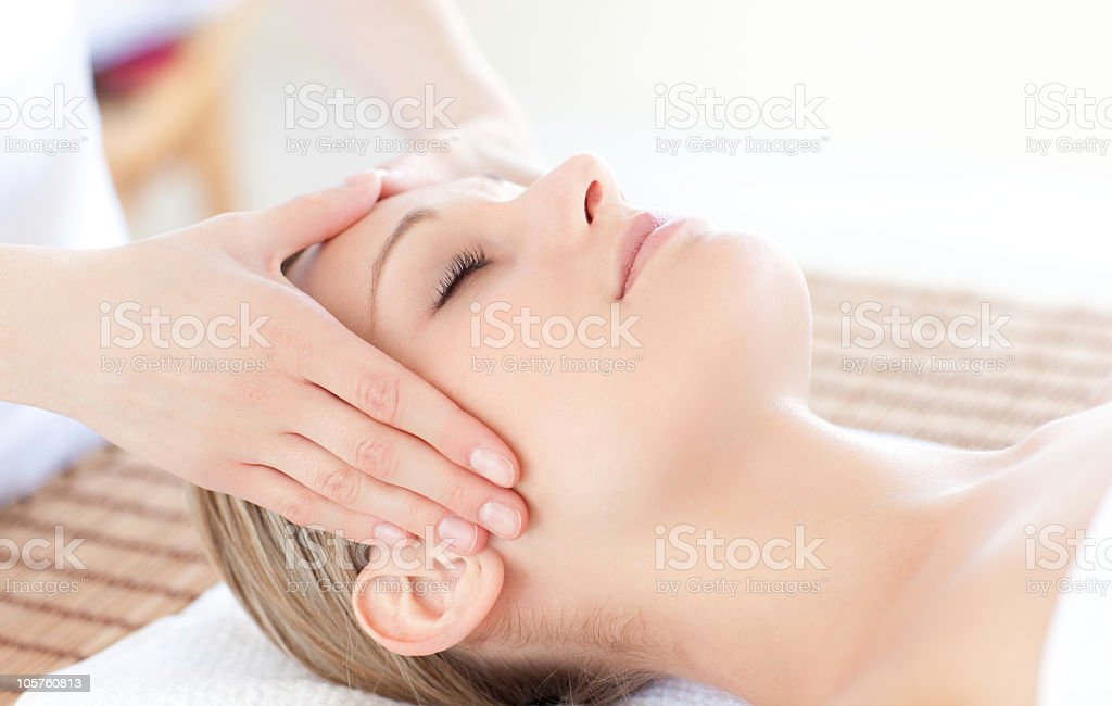 Close-up of a bright woman receiving head massage stock photo