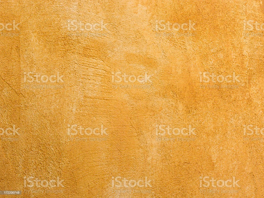 Closeup of a Bright Yellow Textured Stucco Wall royalty-free stock photo