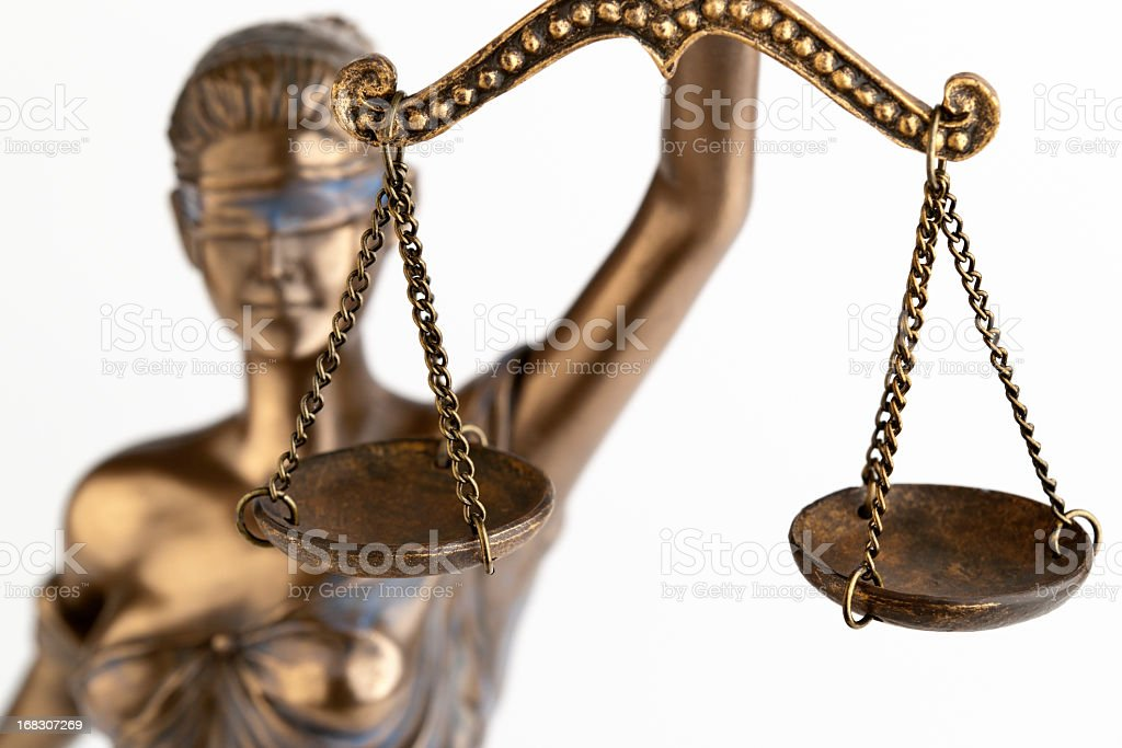 A close-up of a bronze statue of Themis royalty-free stock photo