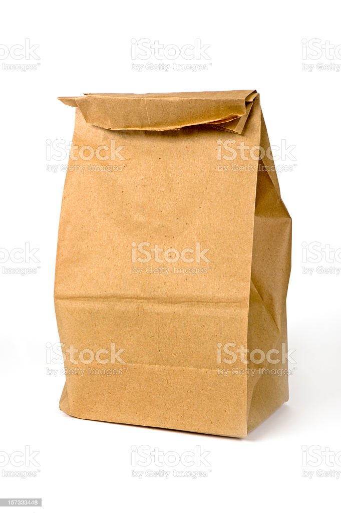 Closeup of a brown paper bag lunch isolated on white stock photo