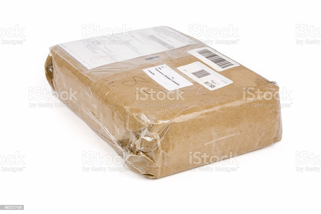 A closeup of a brown paper package, covered in clear tape stock photo