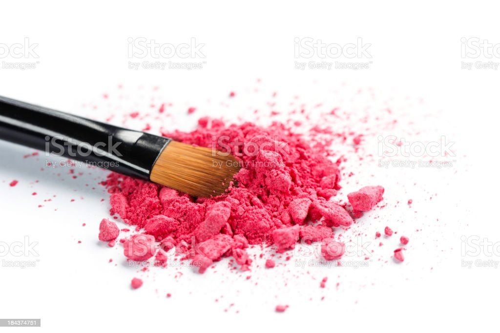 Close-up of a brush laying in crushed cosmetics stock photo