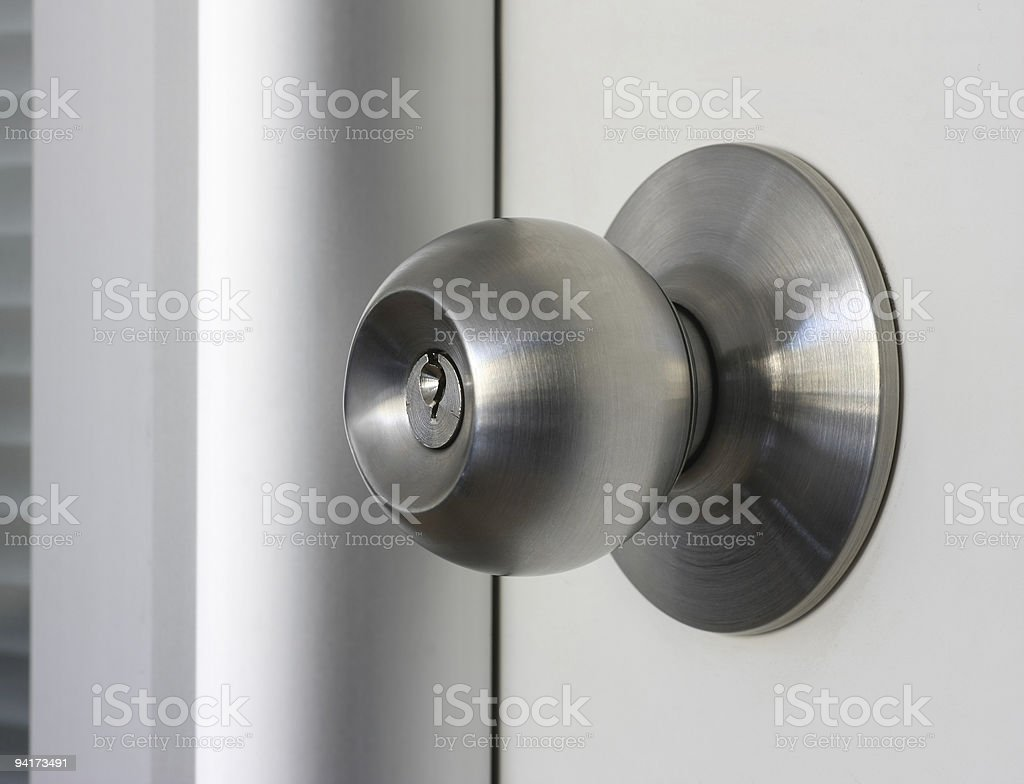 Close-up of a brushed metal door knob stock photo