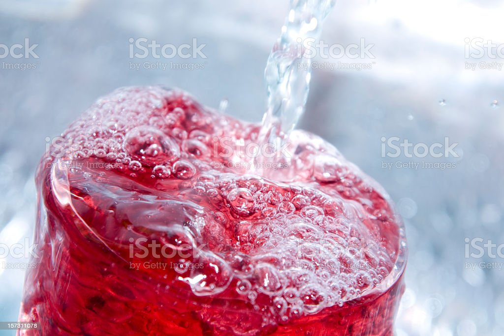 Close-up of a bubbly red drink stock photo