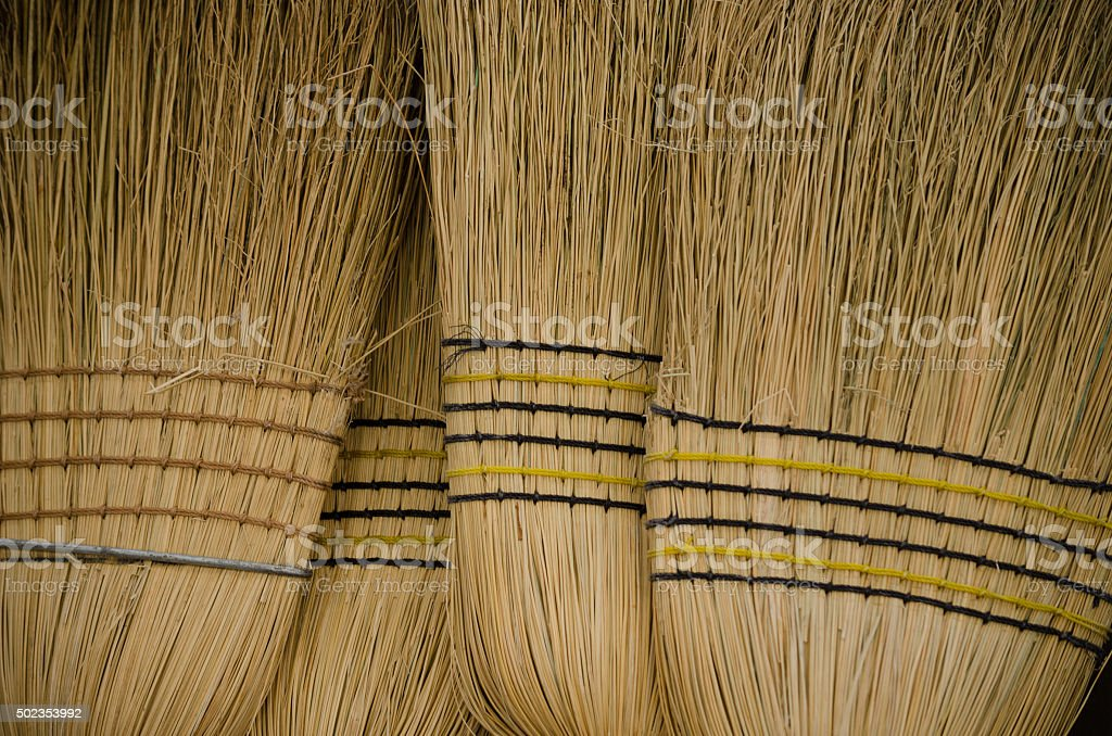 Close-up of a Bunch of Brooms stock photo