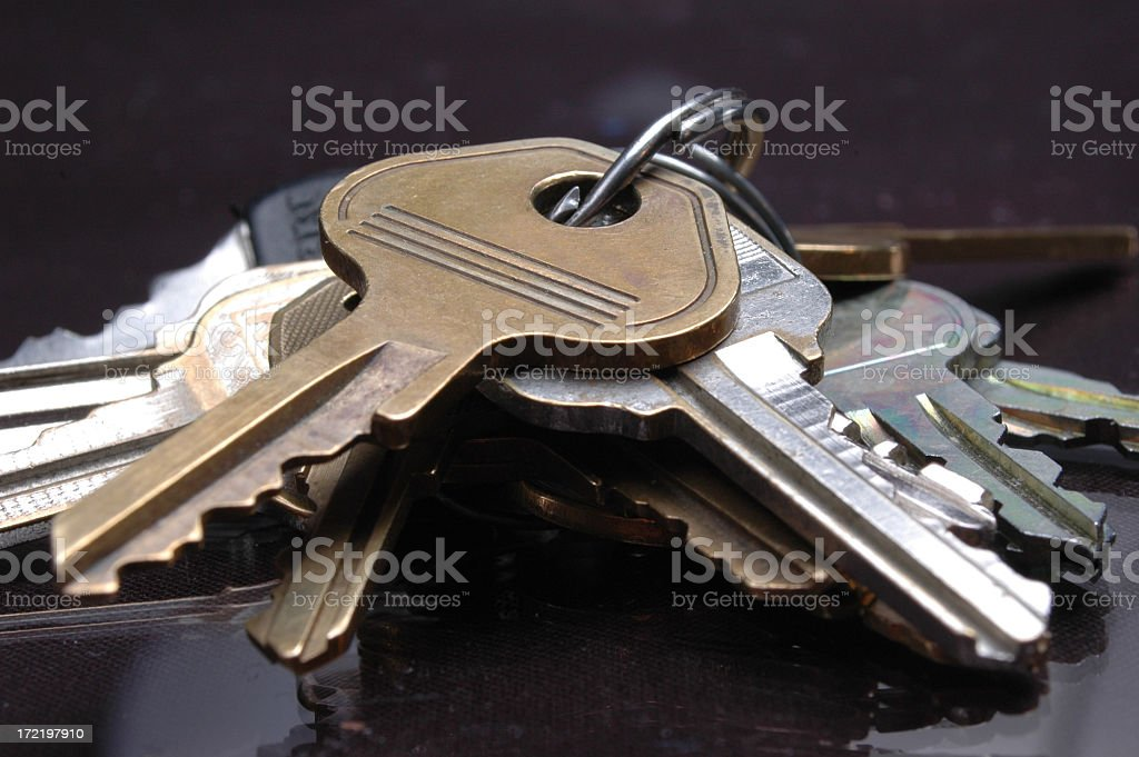 Close-up of a bunch of keys on a desk stock photo