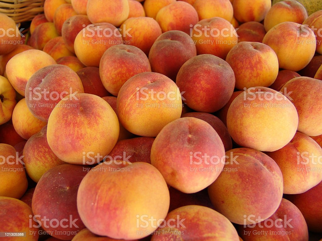 Close-up of a bunch of ripe peaches royalty-free stock photo