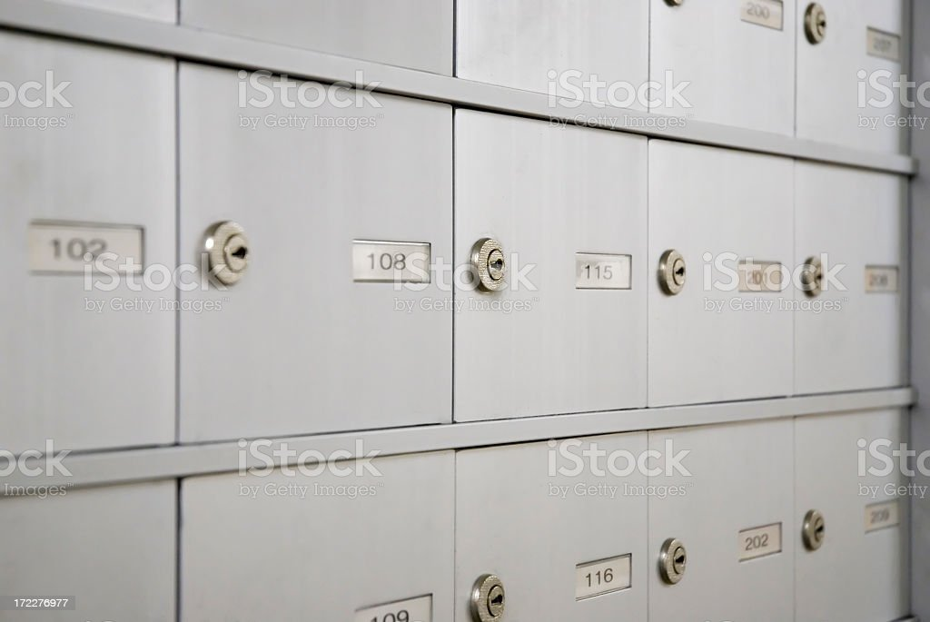 Closeup of a bunch of small mailboxes royalty-free stock photo