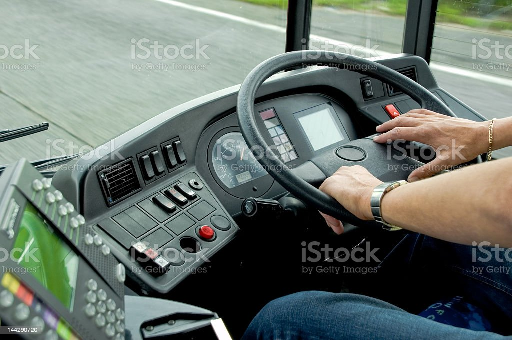 Closeup of a bus driver steering a bus stock photo