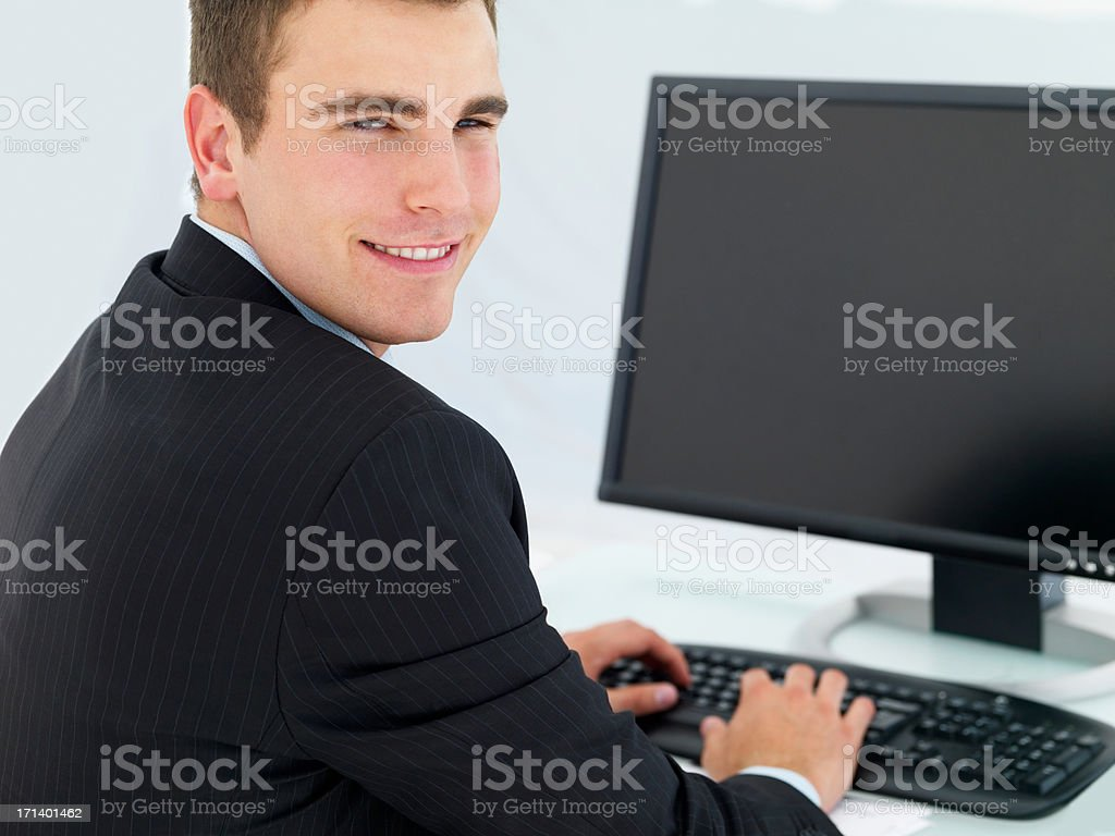 Closeup of a business man using computer at office desk royalty-free stock photo