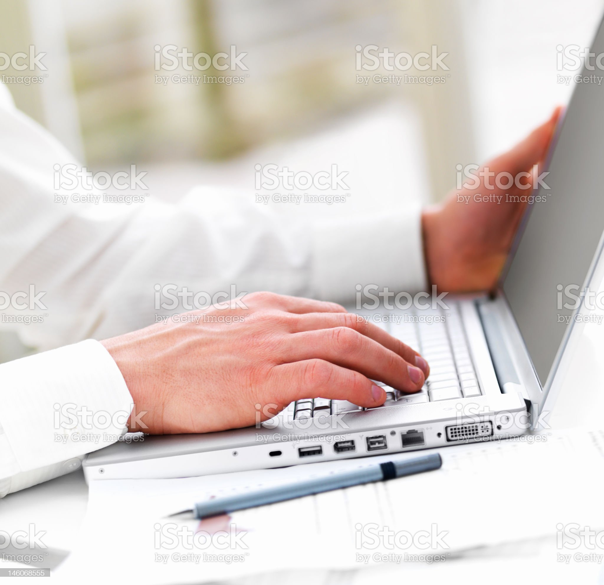 Close-up of a business man's hands working on laptop royalty-free stock photo