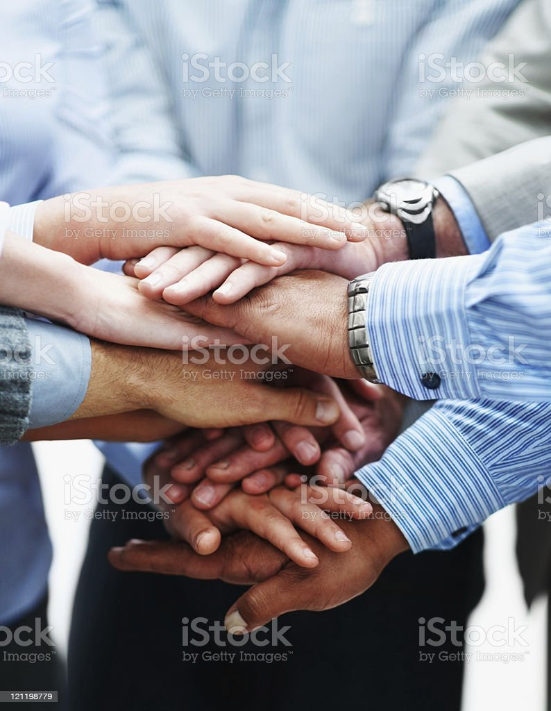 Closeup of a business people with hands together stock photo