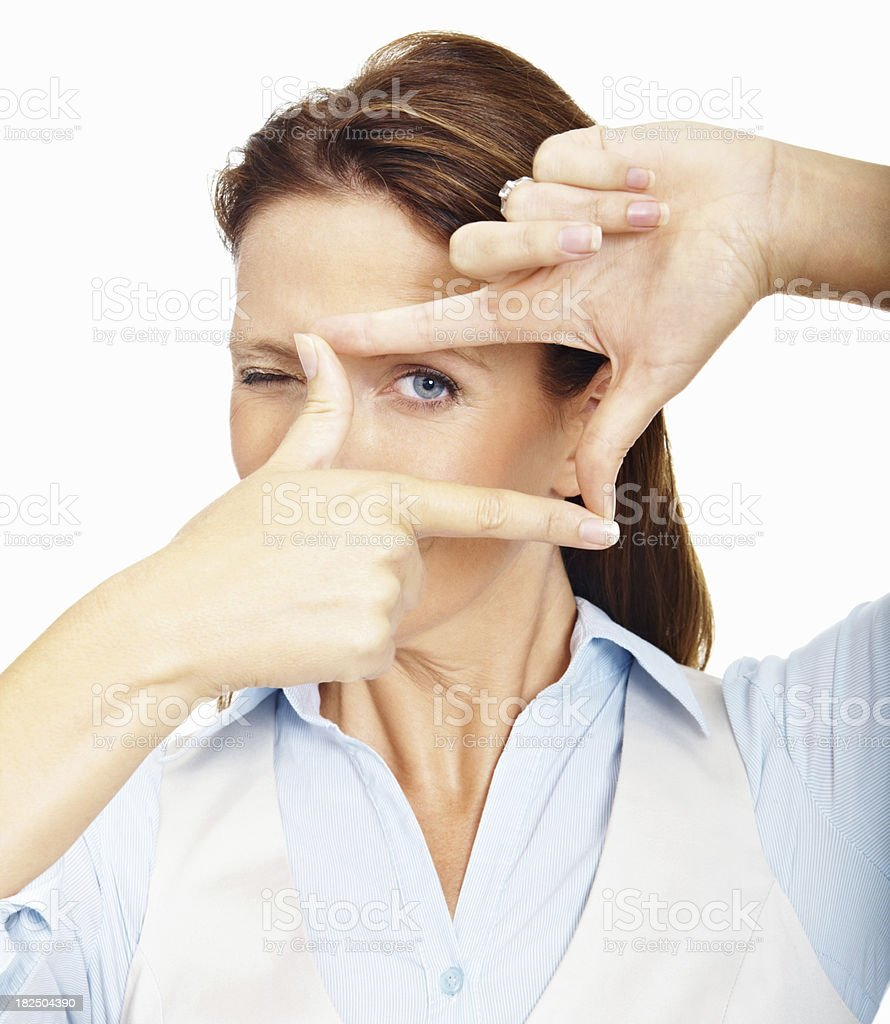 Closeup of a business woman looking through finger frame royalty-free stock photo