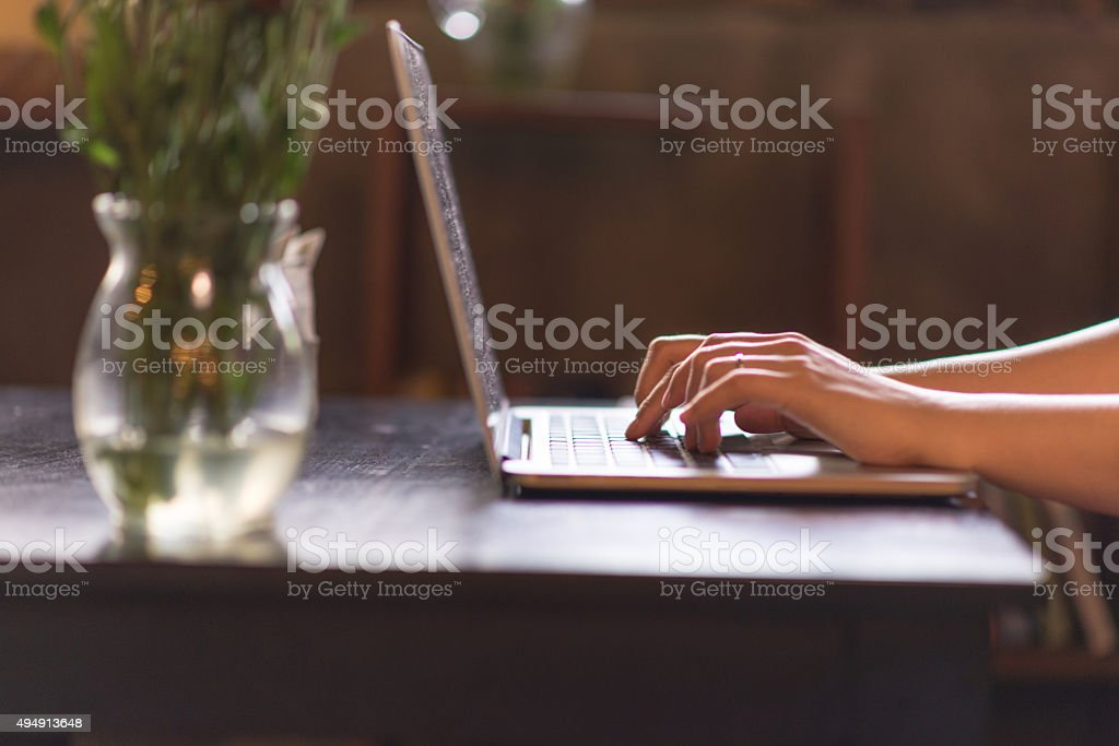 Close-up of a business woman's hands working on laptop stock photo