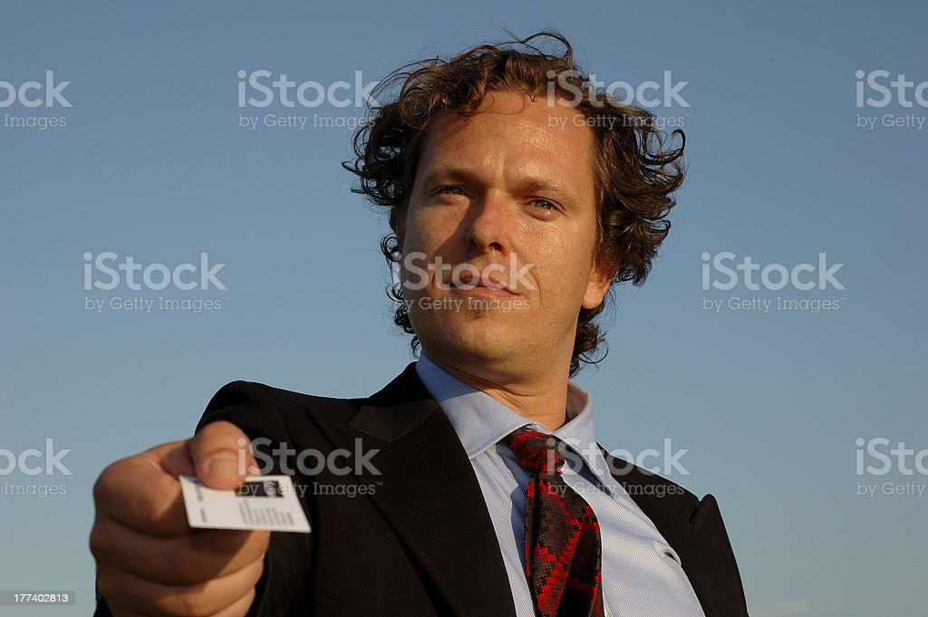 Closeup of a businessman handing over his business card. stock photo
