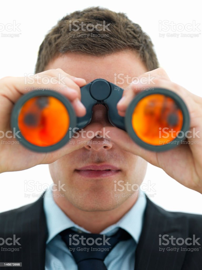 Close-up of a businessman looking through binoculars royalty-free stock photo