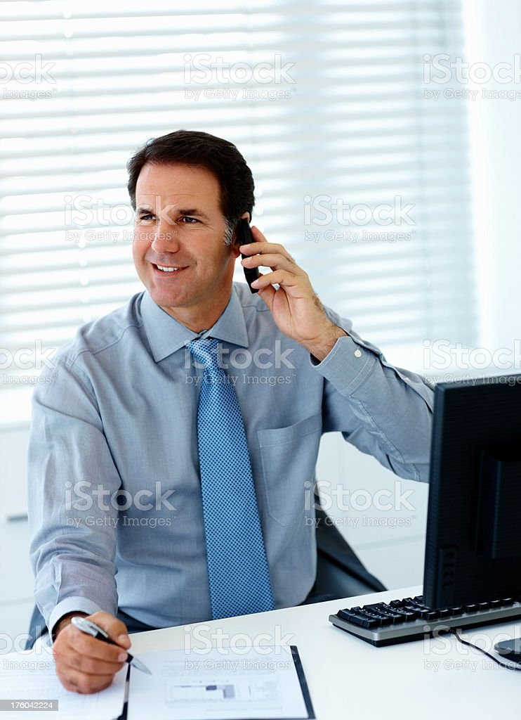 Close-up of a businessman talking on cellphone royalty-free stock photo