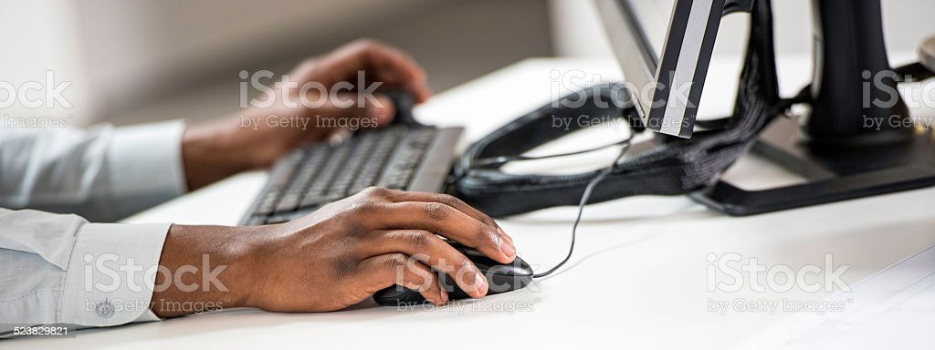 Close-up of a Businessman Working on a Computer stock photo