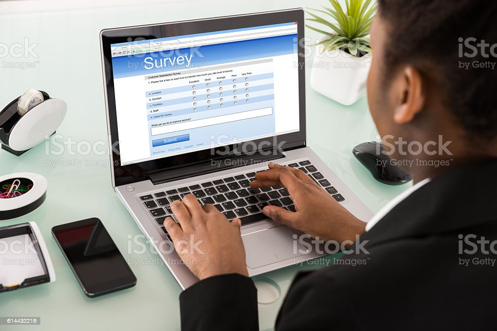 Close-up Of A Businesswoman Filling Online Survey Form stock photo