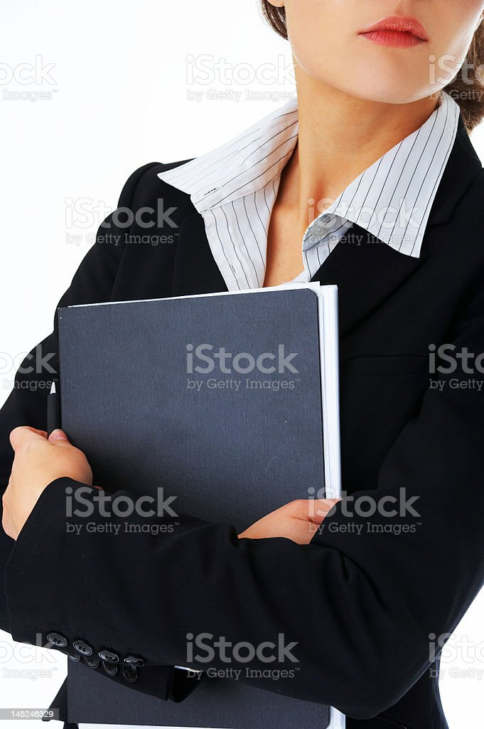Close-up of a businesswoman holding file royalty-free stock photo