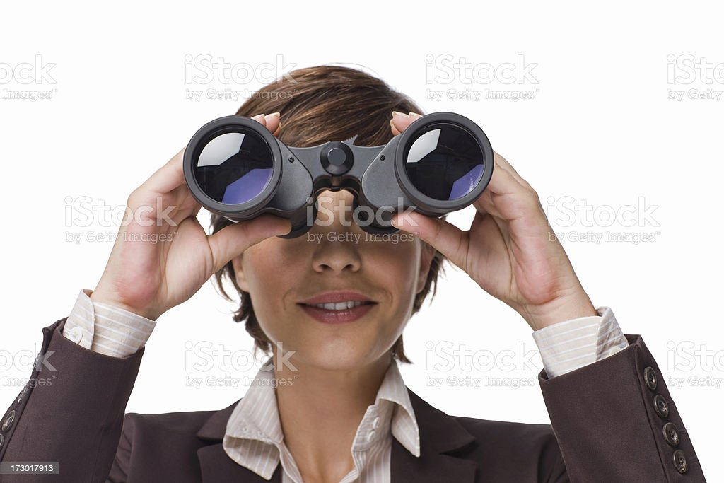 Closeup of a businesswoman looking through binoculars royalty-free stock photo