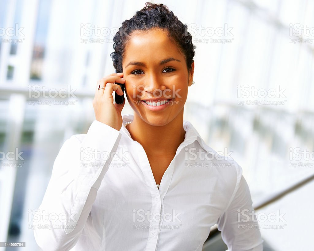Close-up of a businesswoman talking on the mobile phone royalty-free stock photo