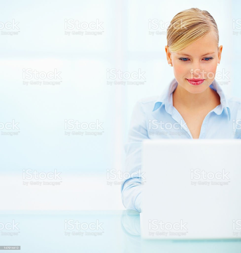 Close-up of a businesswoman using laptop royalty-free stock photo