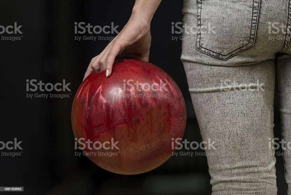 Close-Up Of A Butt Next To Bowling Ball stock photo