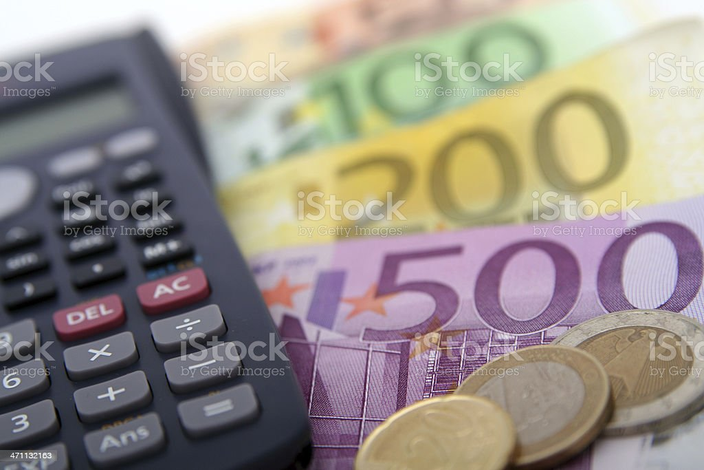 Close-up of a calculator and foreign paper money and coin stock photo