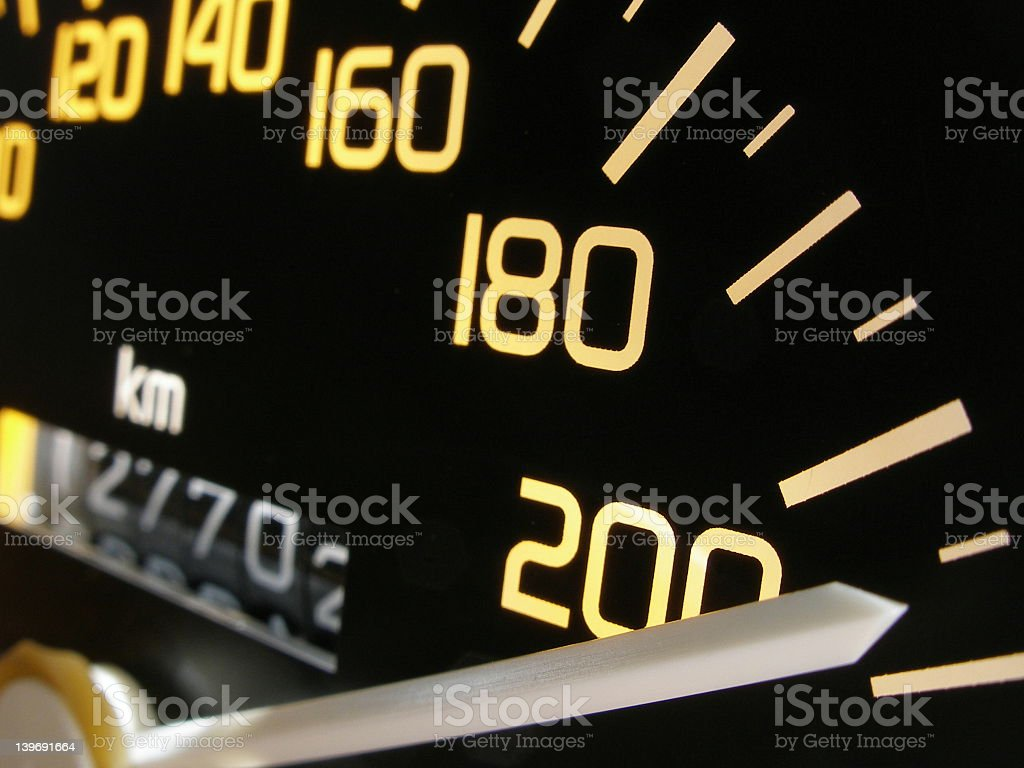 A close-up of a car speedometer royalty-free stock photo