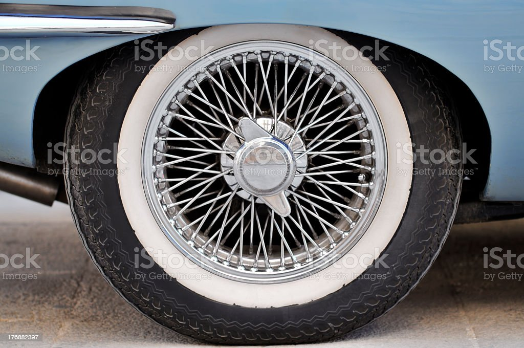 Close-up of a car tire, wire spoke wheel trim and hub nut stock photo