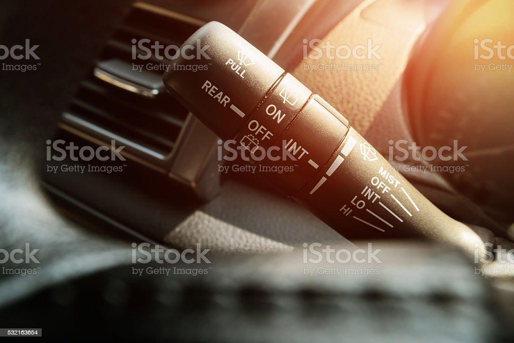 Closeup of a car wiper control. stock photo