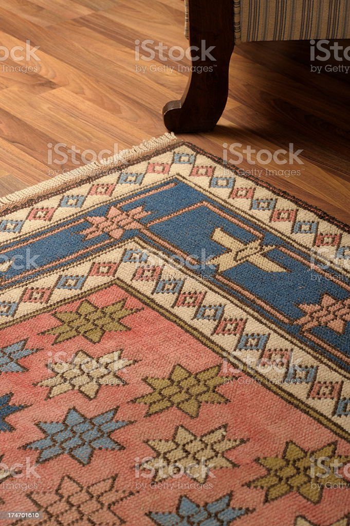 Close-up of a carpet on the wooden floor royalty-free stock photo