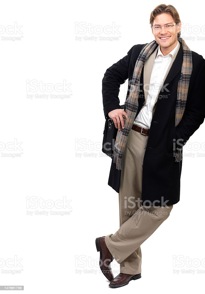 Close-up of a cheerful businessman leaning against white background royalty-free stock photo