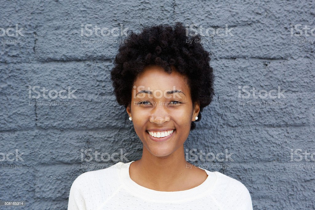 Closeup of a cheerful young woman stock photo