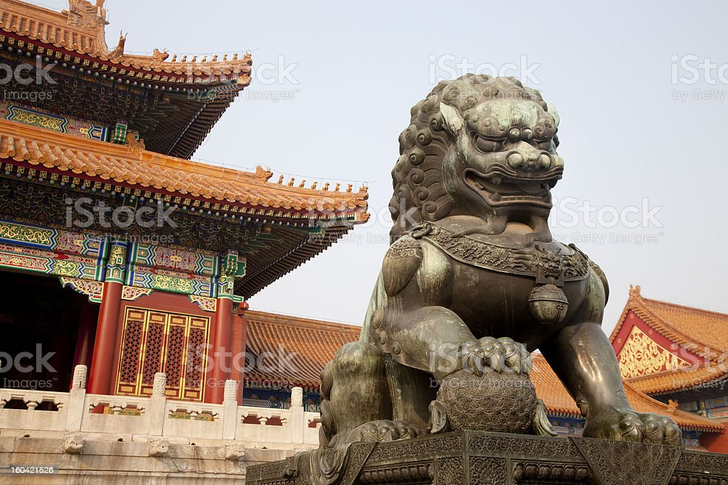 Close-up of a Chinese guardian lion in front of building stock photo