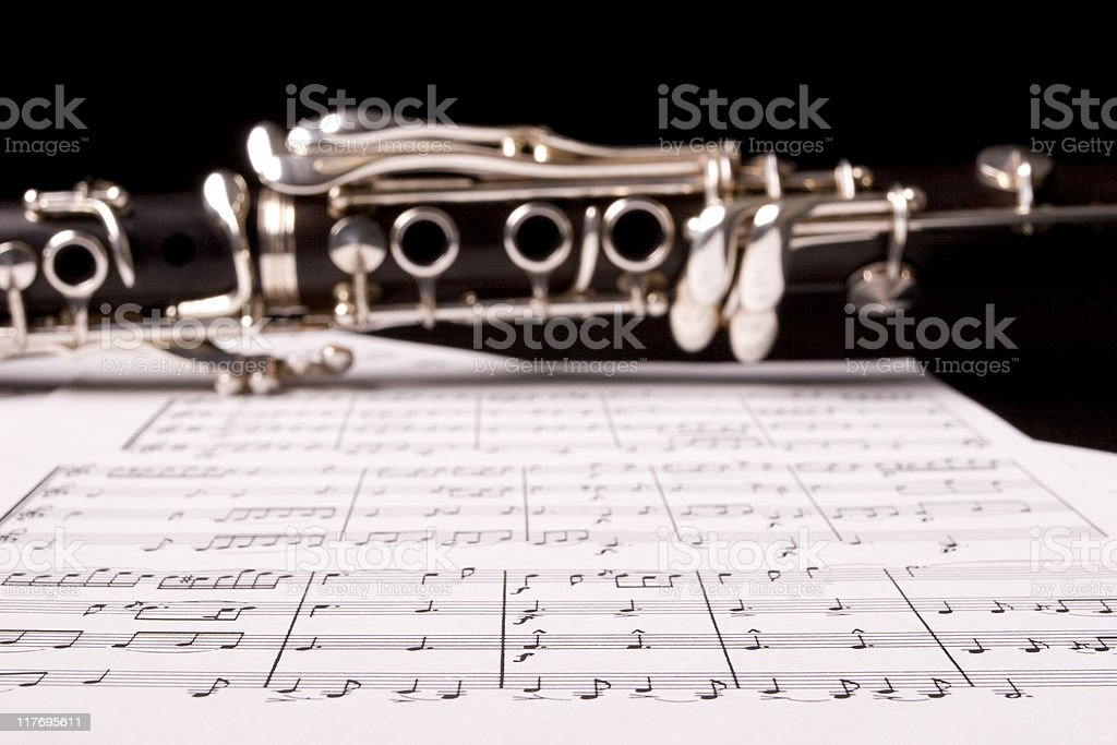 Close-up of a clarinet lying on sheet music royalty-free stock photo