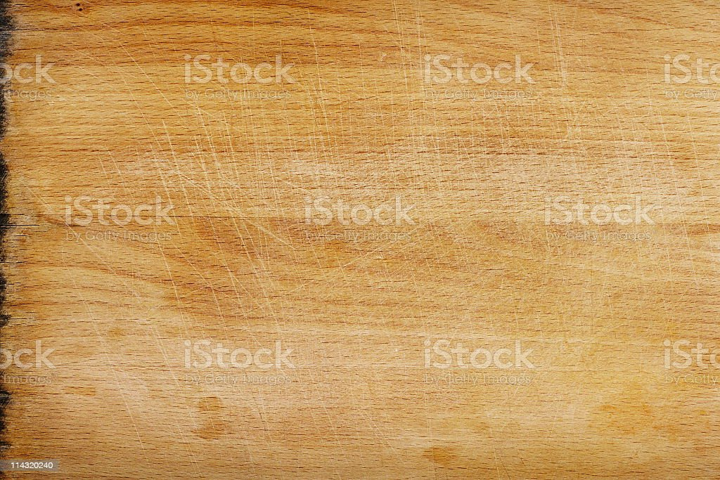 Close-up of a clean but used wooden cutting board surface stock photo
