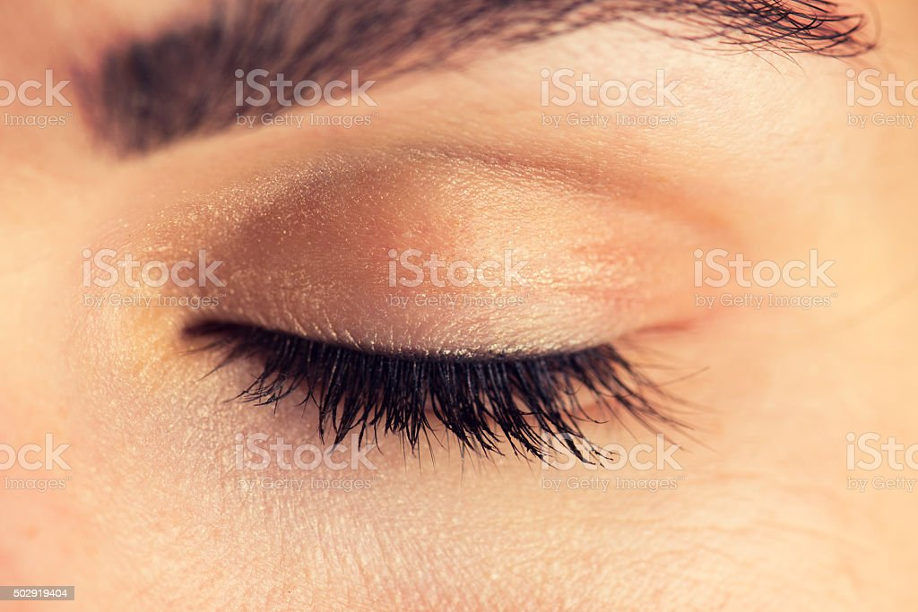 Close-up of a closed eye of a woman stock photo