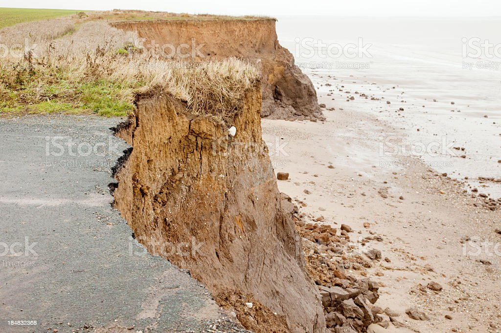 Close-up of a coastal road destroyed over time by erosion stock photo