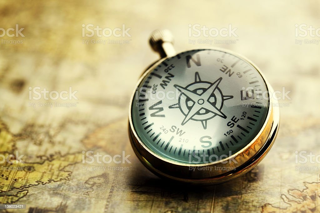 Close-up of a compass on a vintage map royalty-free stock photo