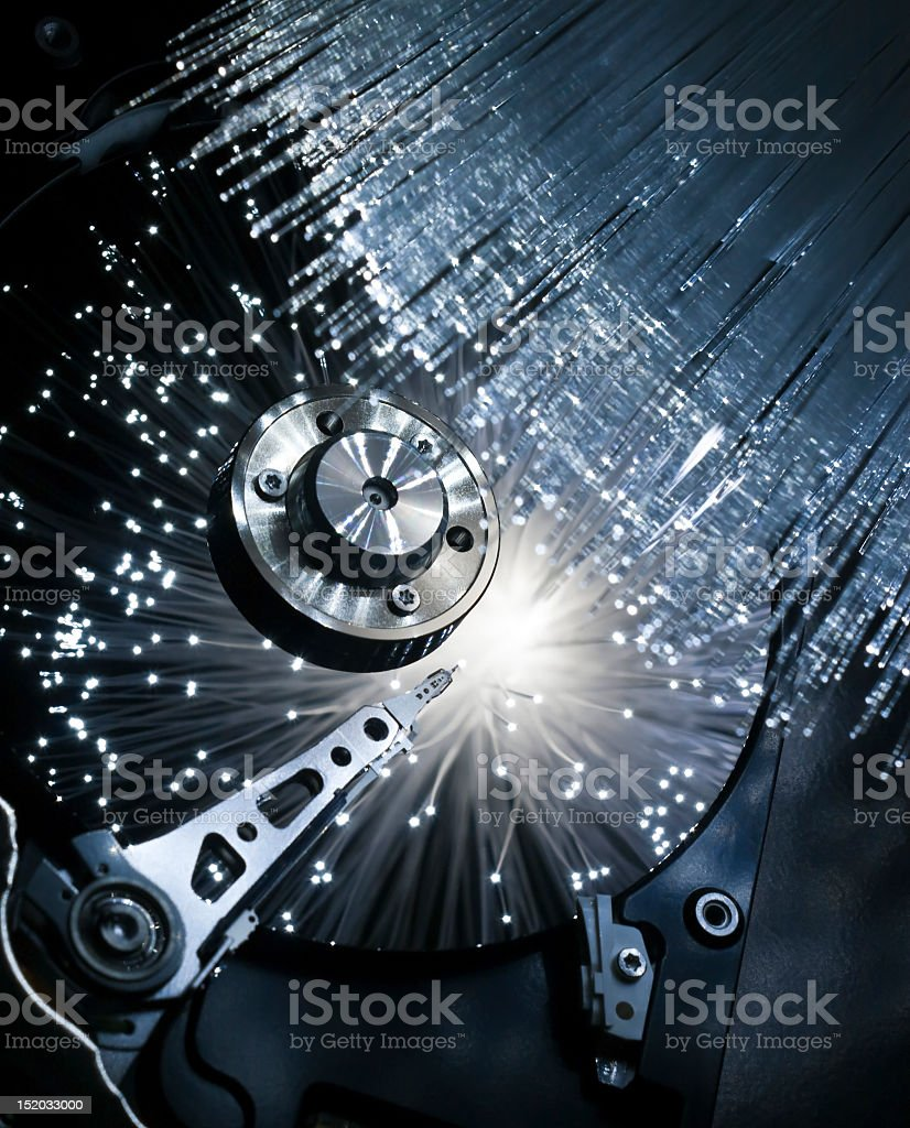 Close-up of a computer hard disk exploding in optic fibers royalty-free stock photo