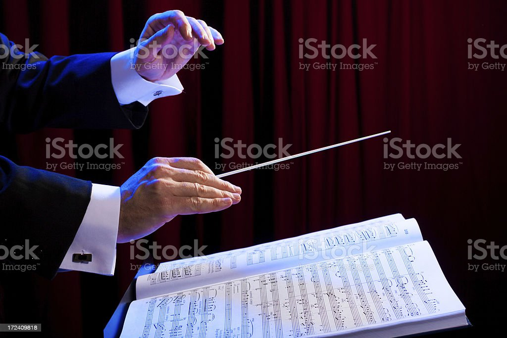 Close-up of a conductors hands conducting music royalty-free stock photo