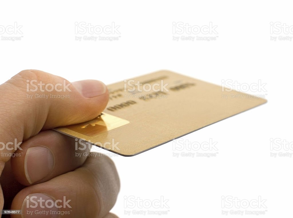 Closeup of a Consumers Hand Holding Gold Credit Card Isolated stock photo