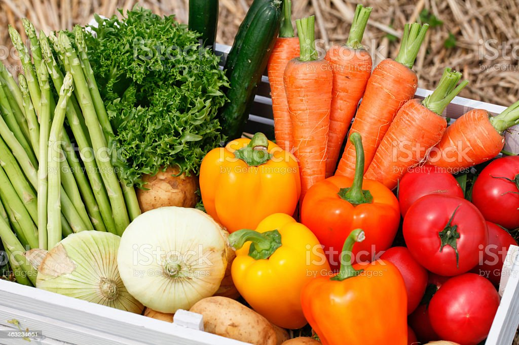 Close-up of a container full of colorful vegetables stock photo