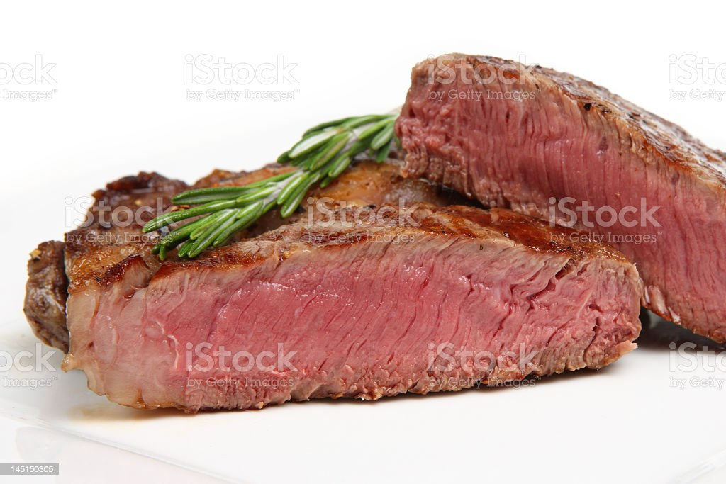 A close-up of a cooked rare sliced steak royalty-free stock photo