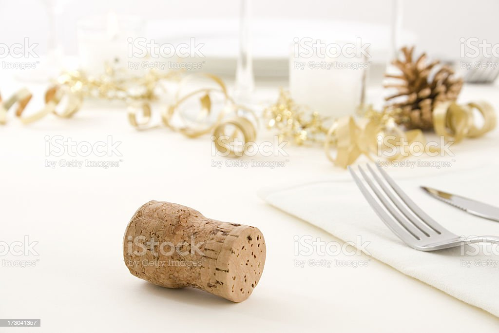 Close-up of a cork from a champagne bottle on a table royalty-free stock photo