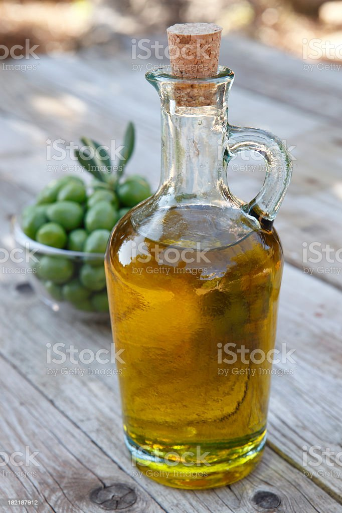 Close-up of a corked bottle of olive oil stock photo