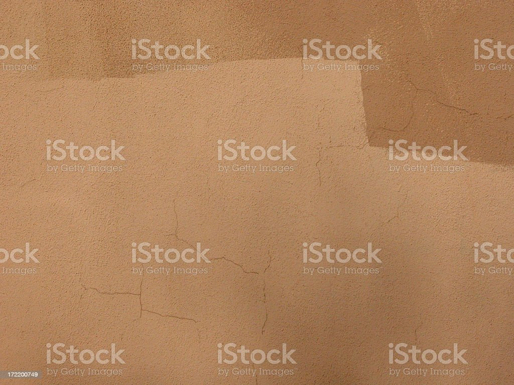 Close-up of a cracked Adobe textured wall royalty-free stock photo